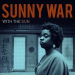 Sunny War Talks Shop With Acoustic Guitar